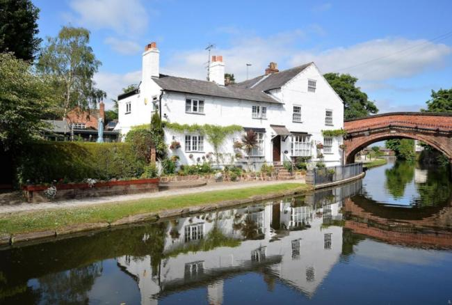 An iconic home by the Bridgewater Canal in Lymm has been put up for sale. All pictures by Rightmove.