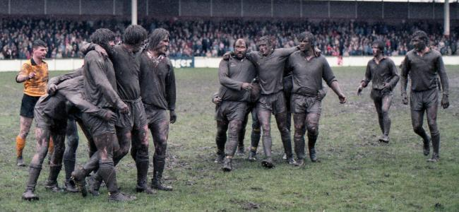 Muddy winter rugby league action at Knowsley Road between St Helens and Warrington Wolves. Picture: Eddie Whitham