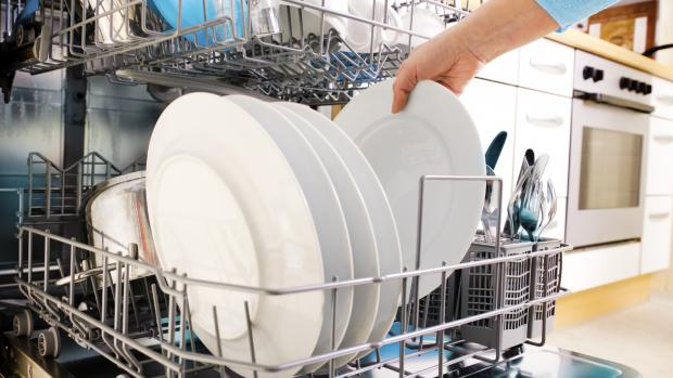 Warrington Guardian: There's a method to the dishwasher organizing madness. Credit: Getty Images