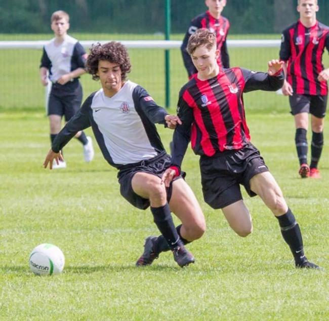 Jamie Benson in action for Appleton AFC