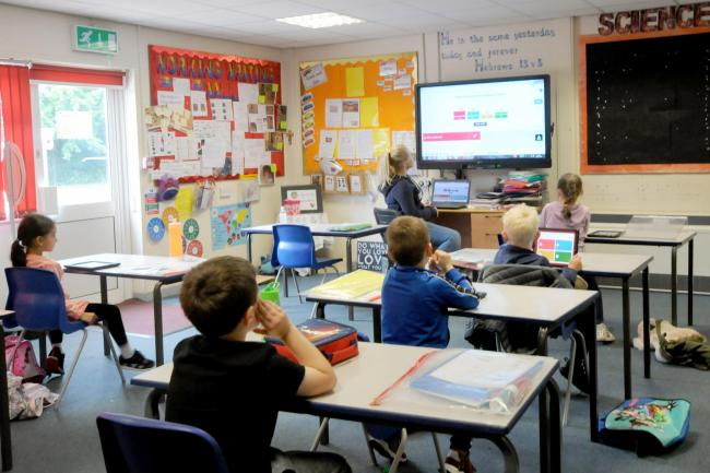 Sacred Heart Primary School pupils in Warrington social distancing in the classroom