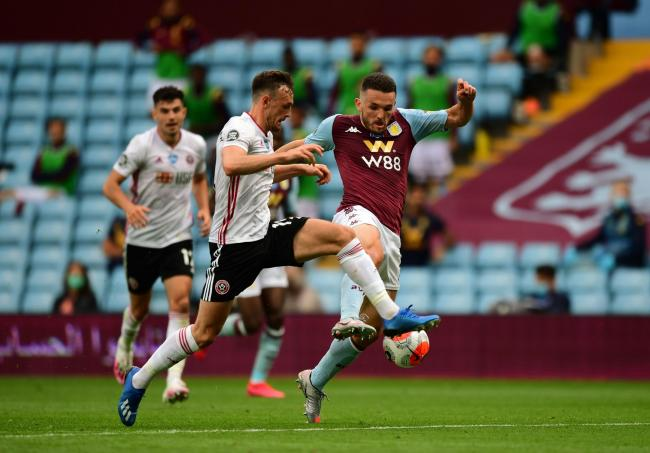 Aston Villa's John McGinn (right) and Sheffield United's Jack Robinson during the Premier League match at Villa Park, Birmingham. Picture: PA Wire