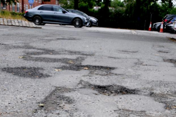 LETTER: Why can't car park's potholes be fixed while vehicles are off the road?
