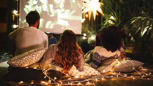 Warrington Guardian: Sit back and relax with a projector and outdoor screen. Credit: Getty Images / M_A_Y_A