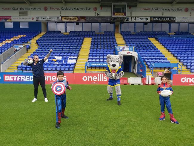 Nine-year-old twins Ruben and Elena Evans-Guillen training with Warrington Wolves star Blake Austin and Wolfie