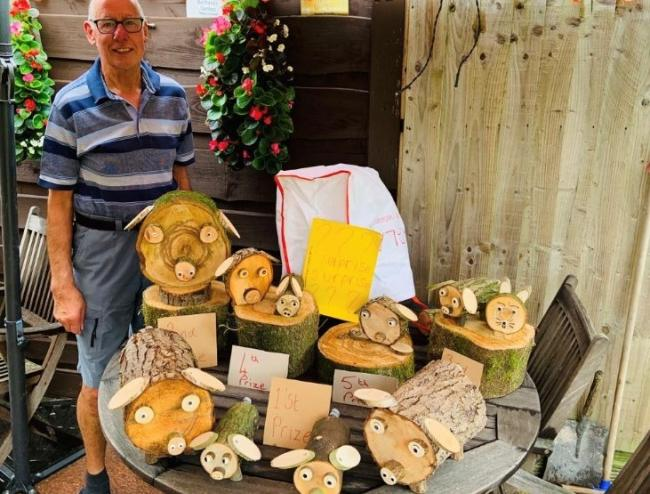 Jeff Stephens and his wooden pig creations