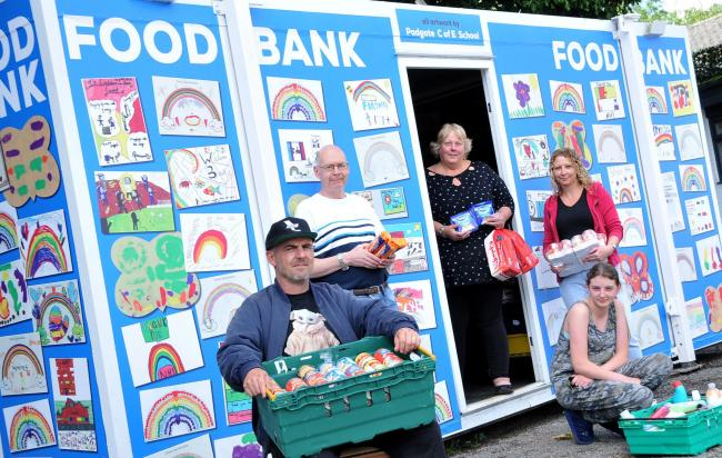 From left at the foodbank are Andi Moran, Andy Warnock-smith, Sue Emery, Katie Mclaughlin and Tazmin Moran