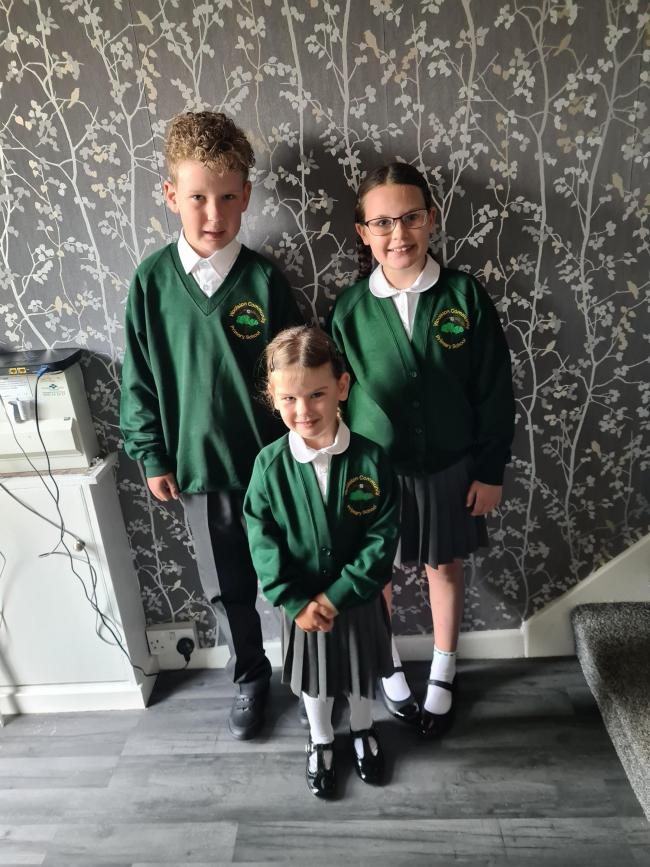 Jaydan-Lee, year six, Lexi-Mai, year five and Imogen Bowen, reception, at Woolston Community Primary School
