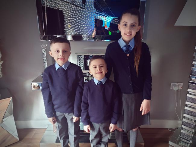 Luca Harrison, year three, Finley Harrison, year one, and Maisey Rawlinson, year six, from St Elphin's Primary School