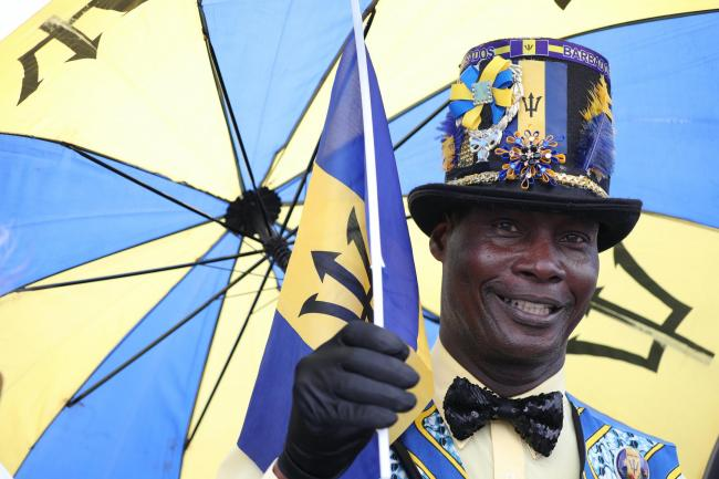 Barbadian Aidan Taylor, dressed in the national colours of his country, during a royal visit to the Commonwealth nation. Jane Barlow/PA Wire