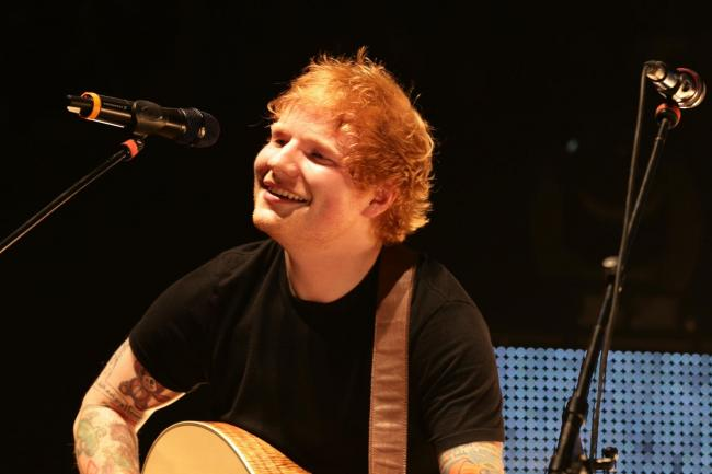 Ed Sheeran performing on stage during the Teenage Cancer Trust series of charity gigs