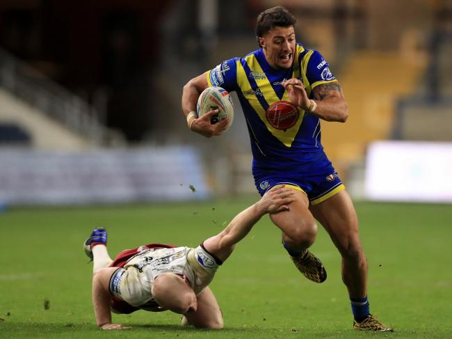 Anthony Gelling on the attack for Warrington Wolves against his former club Wigan Warriors as The Wire made it to 15 games in Super League this year, enabling them to be eligible for the play-offs if they finish in the top flour. Picture: SWpix.com