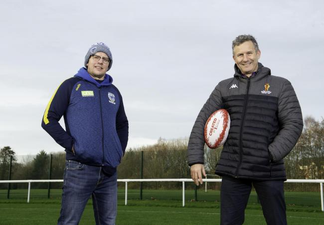 Warrington Wolves's Foundation director Neil Kelly with Adam Hills.at Victoria Park
