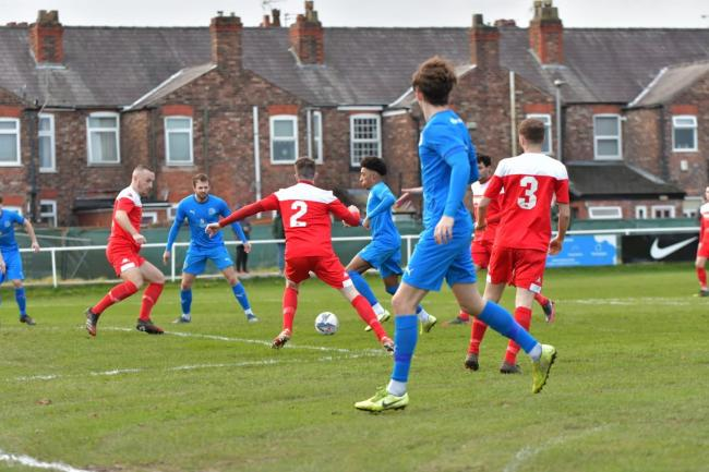 Kane Drummond opens the scoring against Longridge Town. Picture by Mark Percy