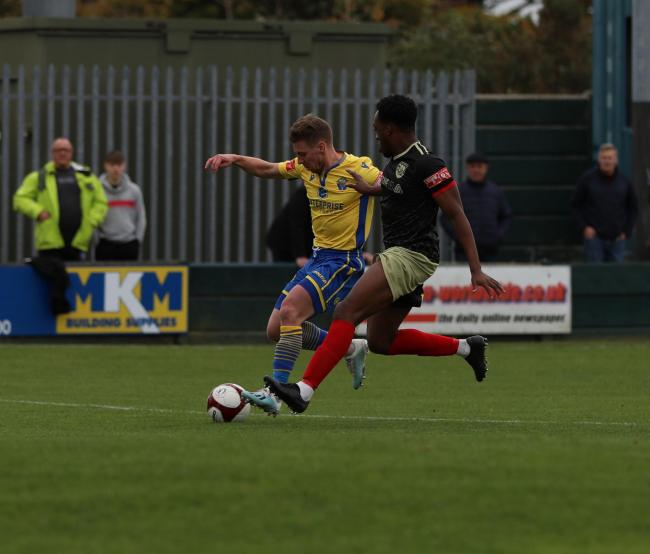 Warrington Town's last win before football ground to a halt - a 2-1 victory over Radcliffe in October. Picture by Darren Murphy
