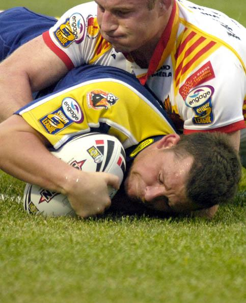 Warrington Guardian: Lee Briers touches down his first try against Les Catalans in Perpignan. Picture by Mike Boden