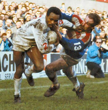 Warrington Guardian: Des Drummond grapples to break free