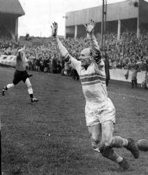 Warrington Guardian: Brian Bevan celebrates a try for Warrington. Picture: EDDIE WHITHAM