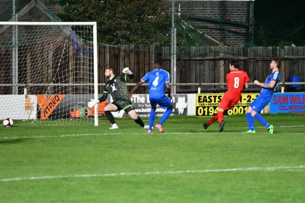 Andy Scarisbrick scores against Whitby. Picture by Mark Percy