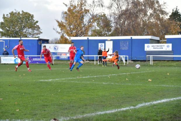 Elliot Nevitt nets one of his two goals against Padiham. Picture by Mark Percy