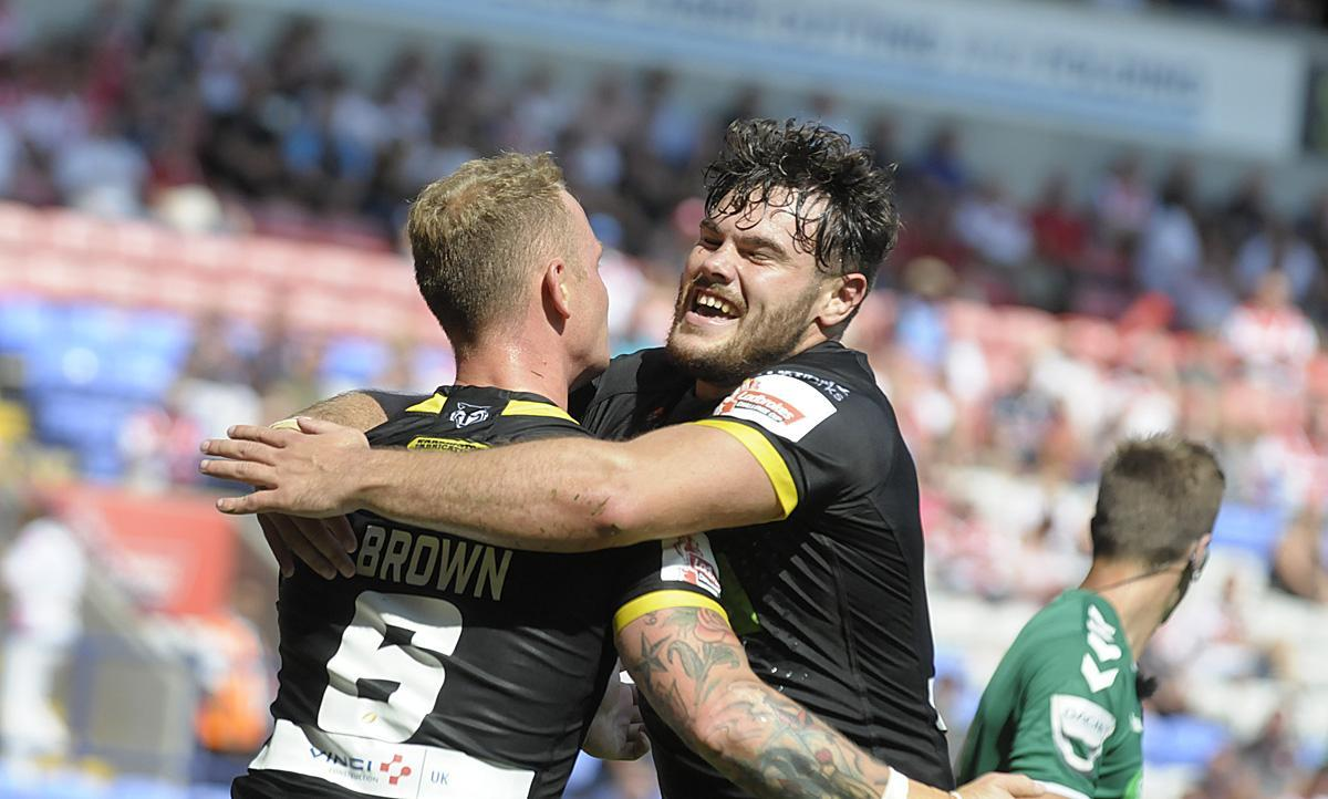 Joe Philbin and Kevin Brown celebrate the latters try against Leeds in the 2018 Challenge Cup semi-final. Picture by Mike Boden