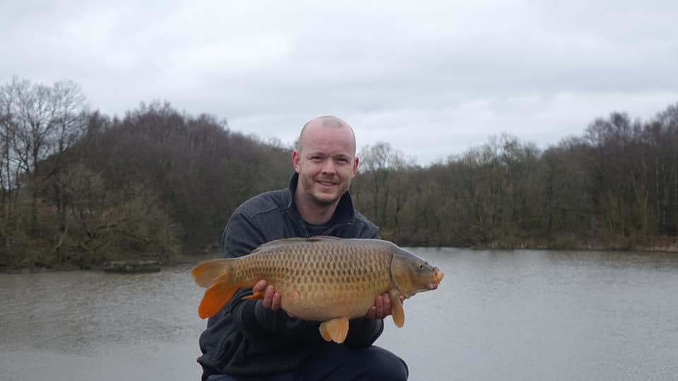 Andrew Sangam with one of the common carp he caught at Worthington Lakes
