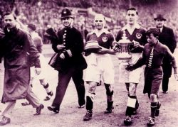 Freddie Worrall holding the base of the FA Cup in Portsmouth's 1939 win at Wembley