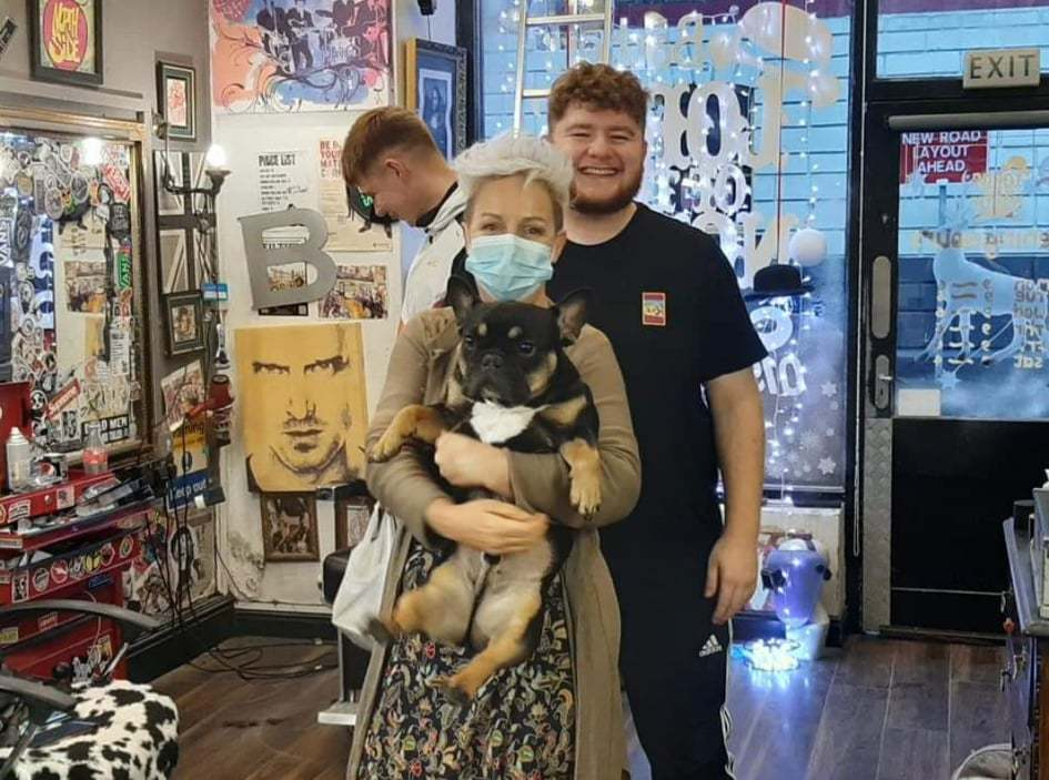 Cheryl Good with her dog Reggie and team members