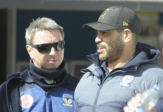 Greg Inglis at Swinton on Sunday alongside Wire head coach Steve Price. Picture by Mike Boden