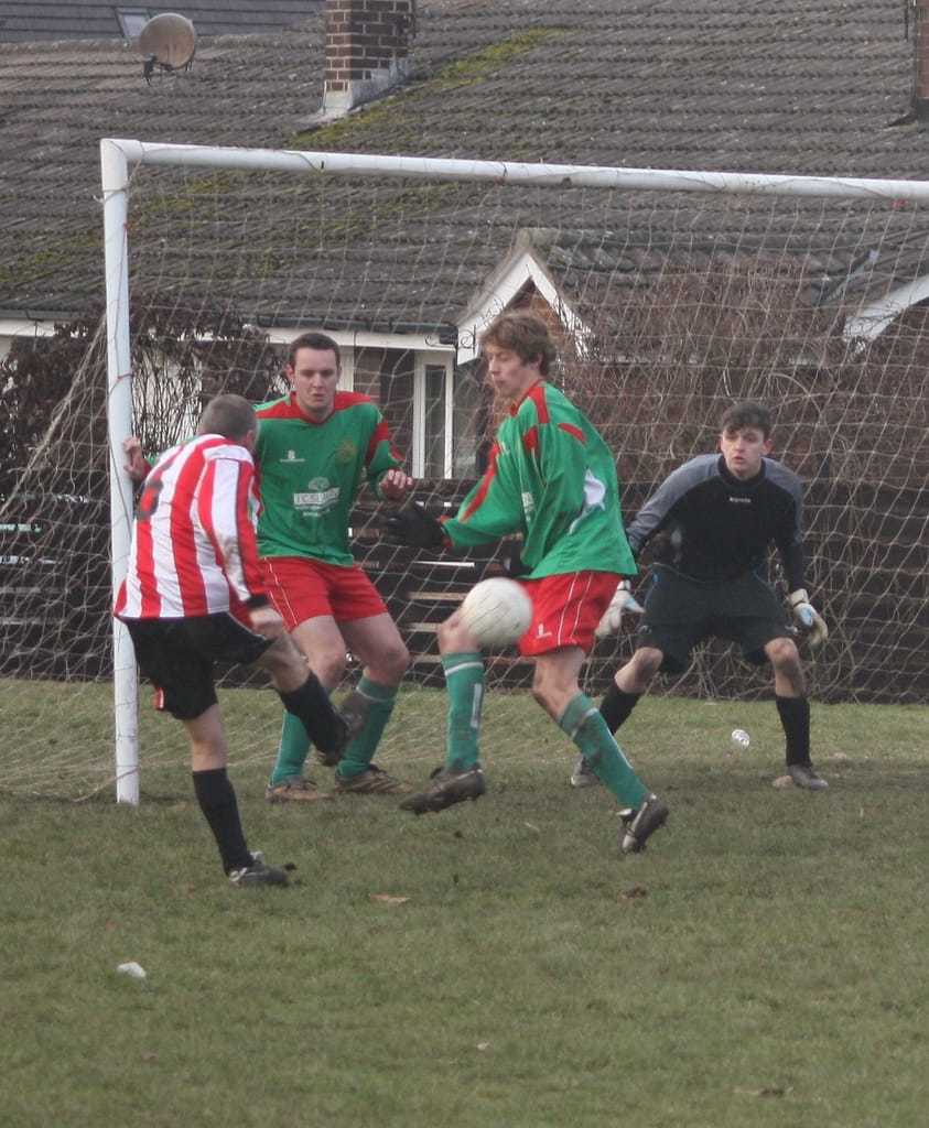 Tom Davies, right, blocks a shot while playing for Lymm AFC. Picture by Lymm AFC