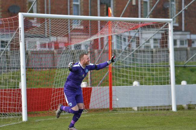 Graeme McCall celebrates saving the penalty that sealed the win over Shildon. Picture by Mark Percy