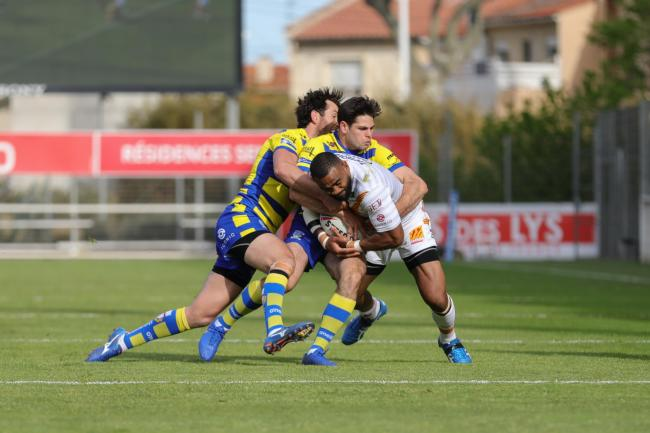 Stefan Ratchford and Jake Mamo tackle Samisoni Langi during The Wire's win at Catalans Dragons. Picture by Catalans Dragons
