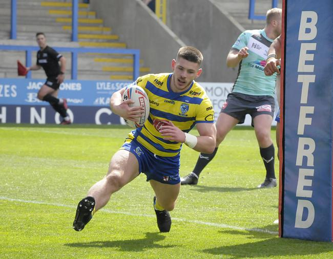 Danny Walker adds a late score for The Wire against Hull KR. Picture by Mike Boden