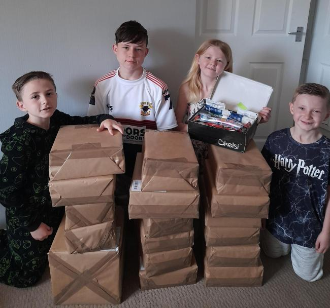 Ashton, Marshall, Lily-Mai and Riley with the care packages ready to be sent overseas