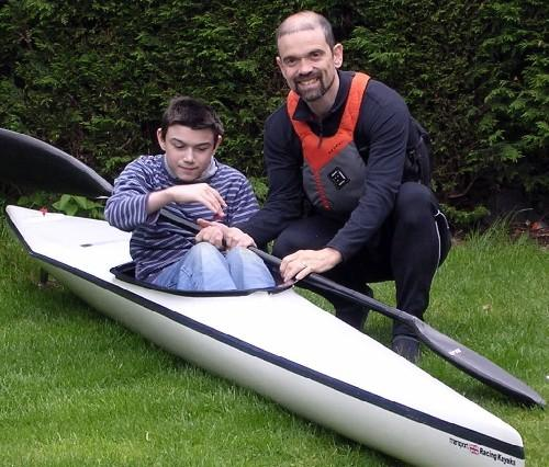 George and Graham in the canoe to be used in the 100-mile race