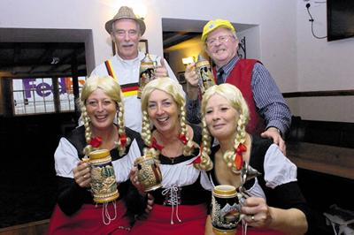 Warrington Guardian: Trowbridge Twinning Society members John Knight and John Beresford, back row, with Trish Carpenter, Caron Collins and Gill Knight in the traditional German dress they will be wearing on their beer garden-themed float