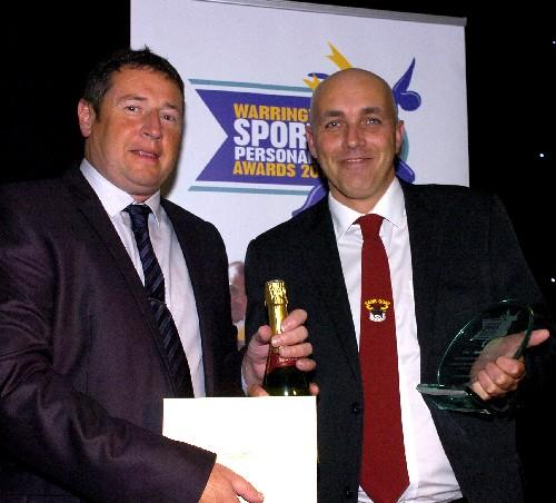 Chris Ball, right, receives his award from Alan Burton, of the Twenty Four Seven design company