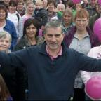 Warrington Guardian: Roy Kettle with supporters of the charity sponsored walk