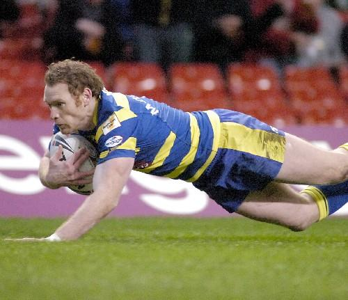 Warrington Guardian: Joel Monaghan touches down his debut Super League try for Warrington Wolves against Huddersfield Giants at the Millennium Stadium in Cardiff. Pictures by Mike Boden