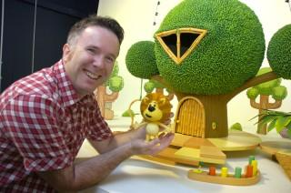 Warrington Guardian: Curtis Jobling proudly shows off Raa Raa the Noisy Lion at the Chapman Studios in Altrincham