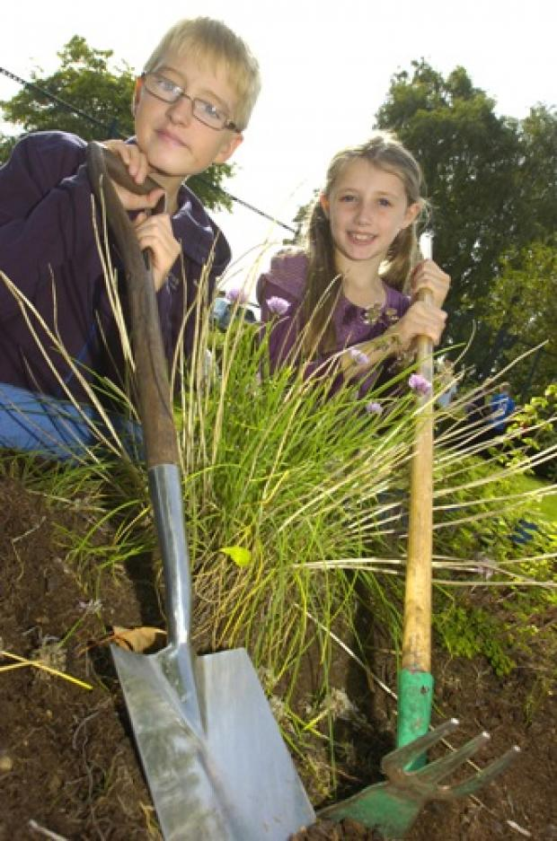 Nathan Hayes, aged 11, and Hollie Glover, aged nine, get digging
