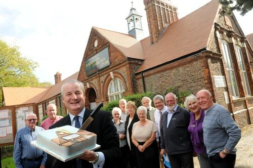 Andrew Wilson, former chairman of the fundraising committee with the cake to mark the official opening