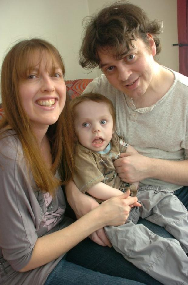 Cameron with parents Sarah and Alan
