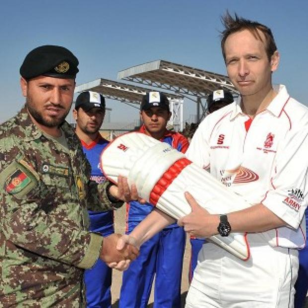 Lt Col Tim Law presenting cricket pads to RSM Saraj Udin as the Afghan cricketers knocked the British Army for six