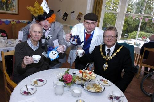 Resident Stephen Carter gets a top up from Mike Carter and Alan Whitefield serves tea to the Mayor of Warrington, Clr Mike Biggin     IPA14312