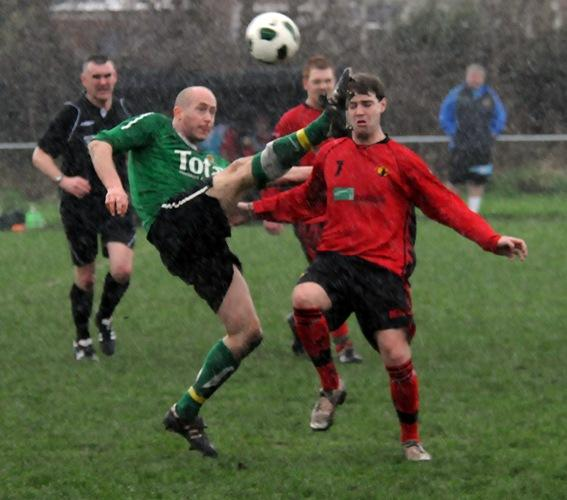 Greenalls, in green, suffered a home defeat against Cheshire League title hopefuls Middlewich Town on Saturday.	Picture: Dave Gillespie DGXP170312