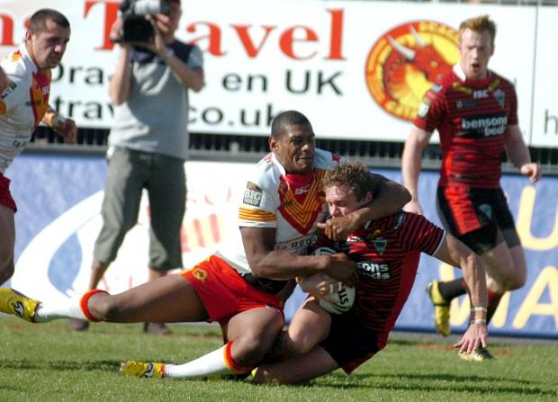 Brett Hodgson is dragged down inches from the line by Leon Pryce.  Pictures by MIKE BODEN