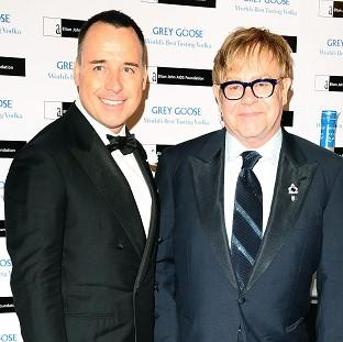 David Furnish and Sir Elton John have said they would like a brother or sister for their son, Zachary