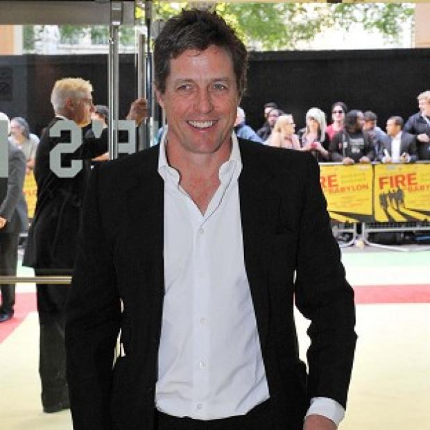 Hugh Grant is proud father to baby Tabitha