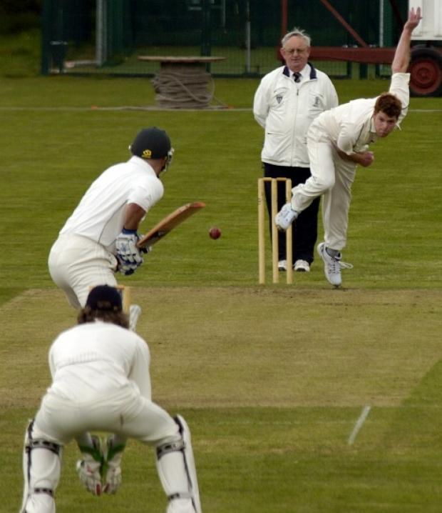 Kyle Adams bowls to Timperley